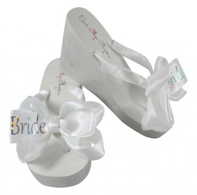 32594cdecde93f White high wedge bridal flip flops with prism silver bride bows